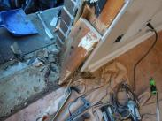 Repairing the damaged door frame