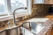 Drumm Design Remodel added contoured, undermounted double sink with a built in sprayer feature in the faucet to this custom kitchen