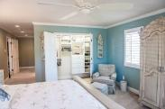 A sweeping view of the entire master bedroom and down the hall to the master bathroom