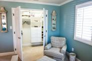 Convenient double doors professionally installed by Drumm Design Remodel, keep this organized closet under wraps