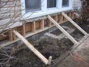 Exterior support braces keep home safe while work is completed